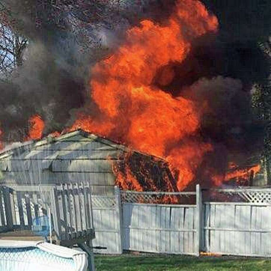 A two-car garage and a vehicle were destroyed in fire on Furman Road in Hamden on Sunday, March 22, 2020. Photo: Hamden Fire Department