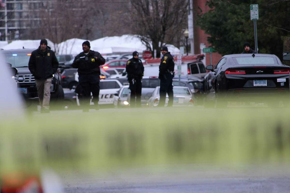 Police blocked off Elizabeth Street Monday morning after three people were found dead in a garage.