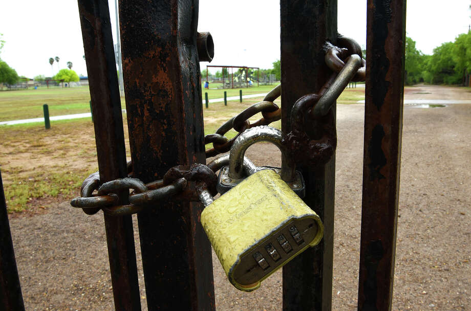A view of the pad locks at the city vehicle entrance for Slaughter Park as seen on, Saturday, Mar. 21, 2020, after the City of Laredo announced the closure of the City Parks System in an effort to encourage social distancing amid the COVID-19 coronavirus concerns. Photo: Danny Zaragoza/Laredo Morning Times