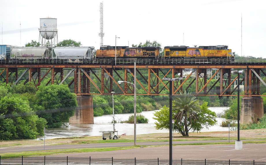 A train crosses the Texas Mexican Railway International Bridge, Friday, Mar. 20, 2020, as seen after travel restrictions were announced at the U.S.-Mexico border amid concerns of COVID-19 Coronavirus spreading. Photo: Danny Zaragoza/Laredo Morning Times