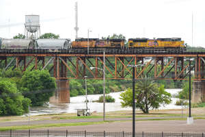 A train crosses the Texas Mexican Railway International Bridge, Friday, Mar. 20, 2020, as seen after travel restrictions were announced at the U.S.-Mexico border  amid concerns of COVID-19 Coronavirus spreading.