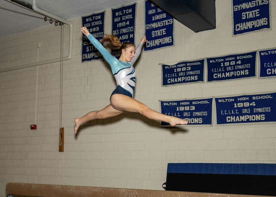 Lilly Byrnes was one of three Wilton gymnasts who made the All-FCIAC first team. Photo: Gretchen McMahon / For Hearst Connecticut Media / (C)GretchenMcMahonPhotography