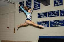 Lilly Byrnes was one of three Wilton gymnasts who made the All-FCIAC first team.
