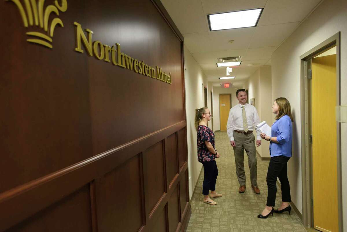 Northwestern Mutual employees, from left to right, Martha Tessitore, director of the sales executive team, Brian Topping, director of supervision, and Maria D'Amelia, chief marketing officer, at the office on Tuesday, March 10, 2020, in Latham, N.Y. (Paul Buckowski/Times Union)