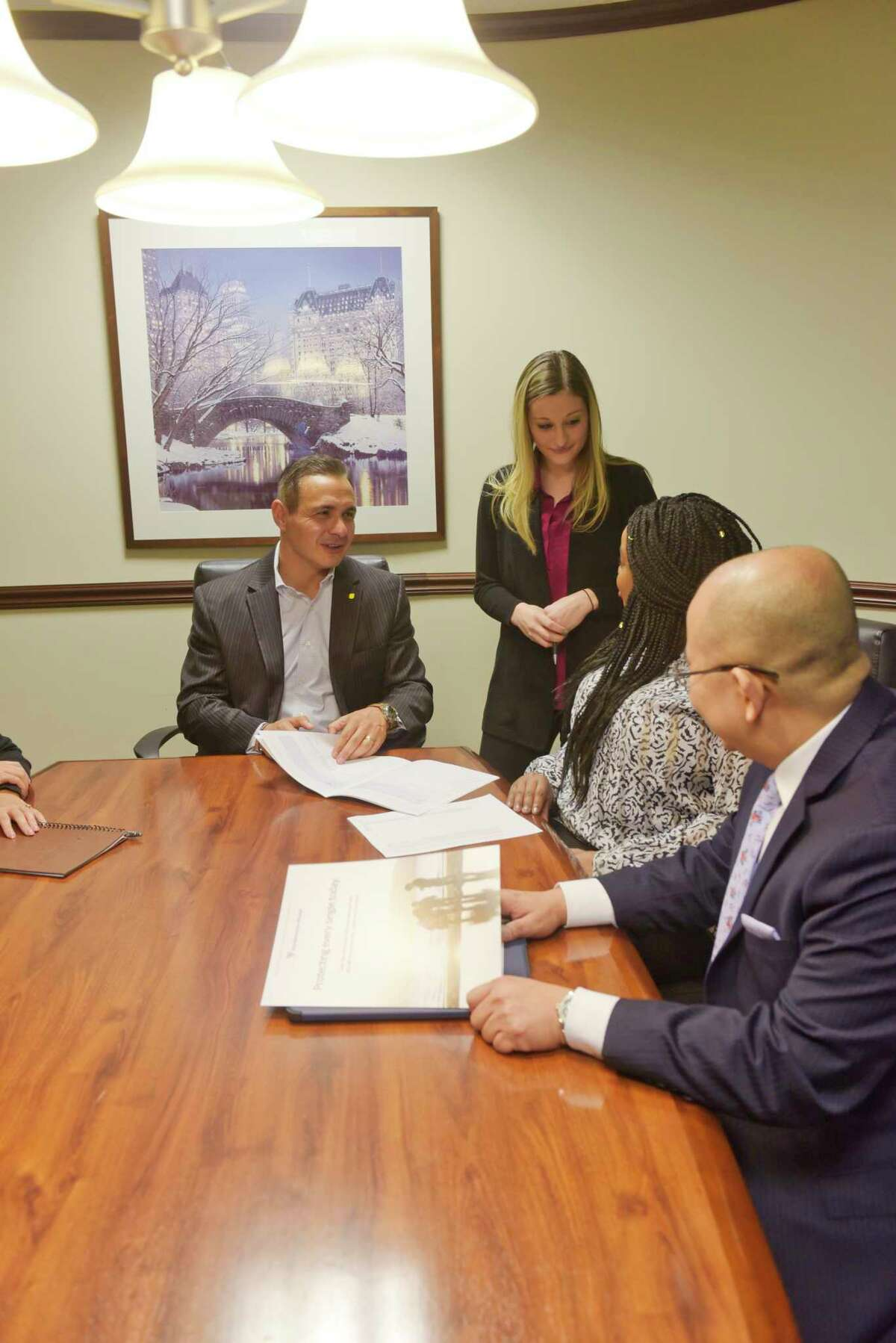 Northwestern Mutual employees, from left to right, Alex Tronco, managing partner, Janelle Krupski, sales executive team member, Rashane Redman, director of client relations and marketing, and Frank Tan, financial advisor, take part in a meeting on Tuesday, March 10, 2020, in Latham, N.Y. (Paul Buckowski/Times Union)