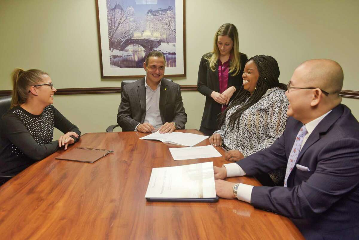 Northwestern Mutual employees, from left to right, Alyssa Johnson, director of client relations, Alex Tronco, managing partner, Janelle Krupski, sales executive team member, Rashane Redman, director of client relations and marketing, and Frank Tan, financial advisor, take part in a meeting on Tuesday, March 10, 2020, in Latham, N.Y. (Paul Buckowski/Times Union)