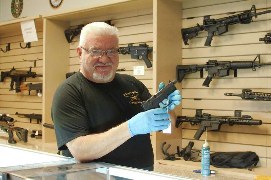 "Battle Rifle Co. owner Chris Kurzadowski says sales have been brisk at his business. ""People who have never owned a gun are walking into the store,"" he says. Photo: Kirk Sides / Staff Photographer / © 2020 Kirk Sides / Houston Chronicle"