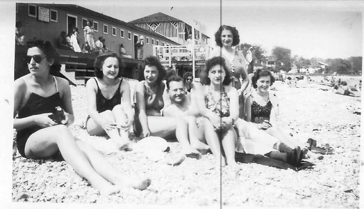 Enjoying the sun in front of Compo Beach pavilion, in the late 1930s, are friends and family of longtime Westport resident Evelyn Palmer Jackson (third from right). The others are, Lena Carusone, Mary Carusone, Theresa Palmer, Leo Sametz, Lucille Purcell and Angie Carusone. The 3 girls on the bikes are Lena Carusone, Evelyn Palmer and Lucille Purcell. Summer 1939 on Wilton Road just south of Kings Highway North.