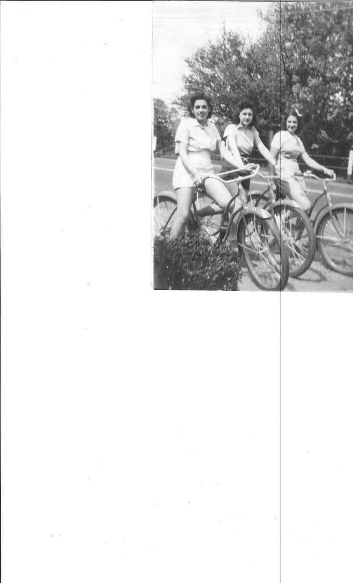Evelyn Palmer Jackson, a longtime Westport resident, is flanked by friends Lena Carusone and Lucille Purcell as they biked in the summer 1939 on Wilton Road.