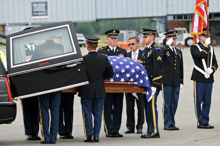 The remains of WWll Army Air Corps 1st Lt. Ray Fletcher arrives at the Albany International Airport on Wednesdasy, Aug. 18, 2010. His final destination is his hometown in Vermont.  (Lori Van Buren / Times Union) Photo: Lori Van Buren
