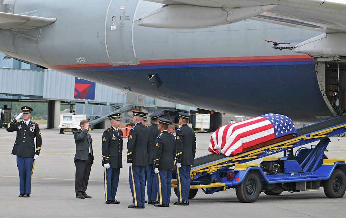 The remains of WWll Army Air Corps 1st Lt. Ray Fletcher arrives at the Albany International Airport on Wednesdasy, Aug. 18, 2010. His final destination is his hometown in Vermont. (Lori Van Buren / Times Union)