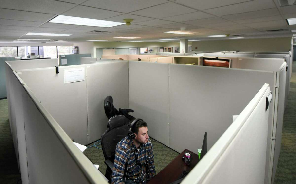 MJ Engineering and Land Surveying geographic information systems technician Scott Brayden works out of his cubical on Thursday, Feb. 27, 2020, at MJ Engineering in Clifton Park, N.Y. (Will Waldron/Times Union)