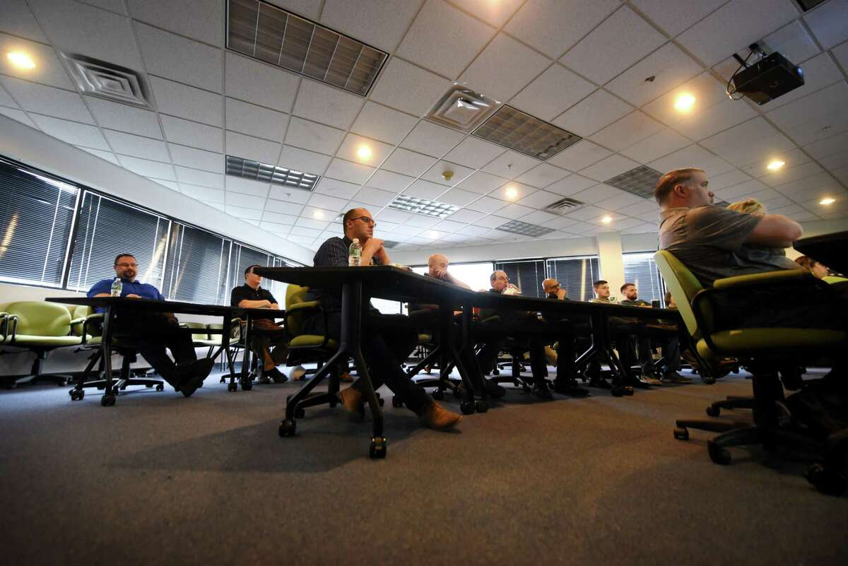 MJ Engineering and Land Surveying employees take part in an training webinar on Thursday, Feb. 27, 2020, at the MJ Engineering offices in Clifton Park, N.Y. (Will Waldron/Times Union)