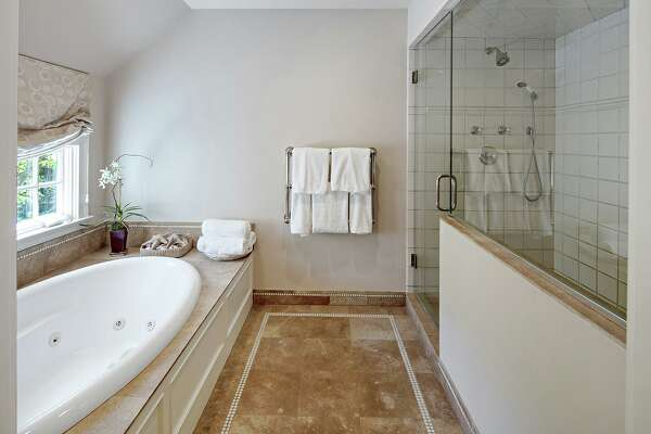 The master bath features a jetted tub and large shower.