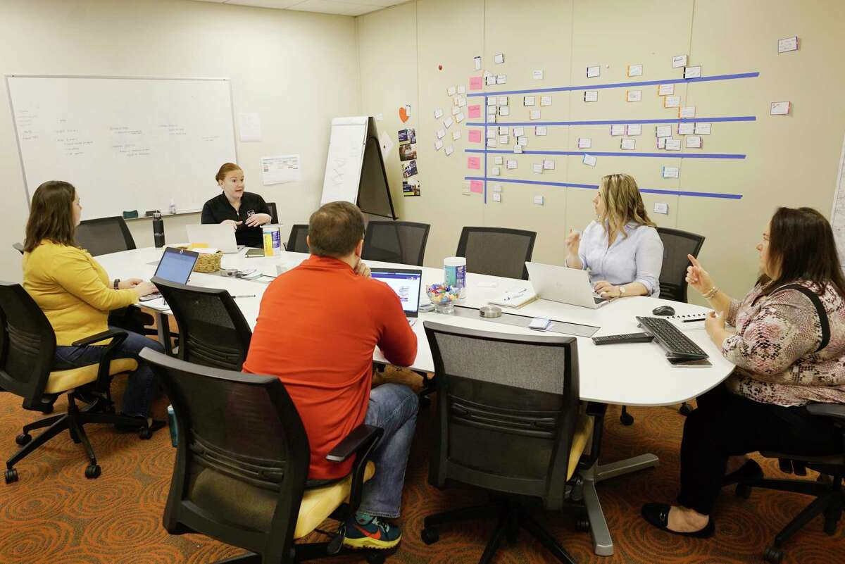 CAP COM marketing team members take part in a meeting on Monday, March 16, 2020, in Colonie, N.Y. (Paul Buckowski/Times Union)
