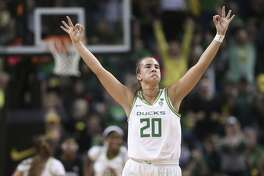 FILE - In this Thursday, Jan. 16, 2020, file photo, Oregon's Sabrina Ionescu celebrates a 3-point shot against Stanford during the third quarter of an NCAA college basketball game in Eugene, Ore. Ionescu capped off a unprecedented college career by entering an exclusive club. Oregon's star guard was a unanimous choice Monday as The Associated Press women's basketball player of the year. (AP Photo/Chris Pietsch, File)