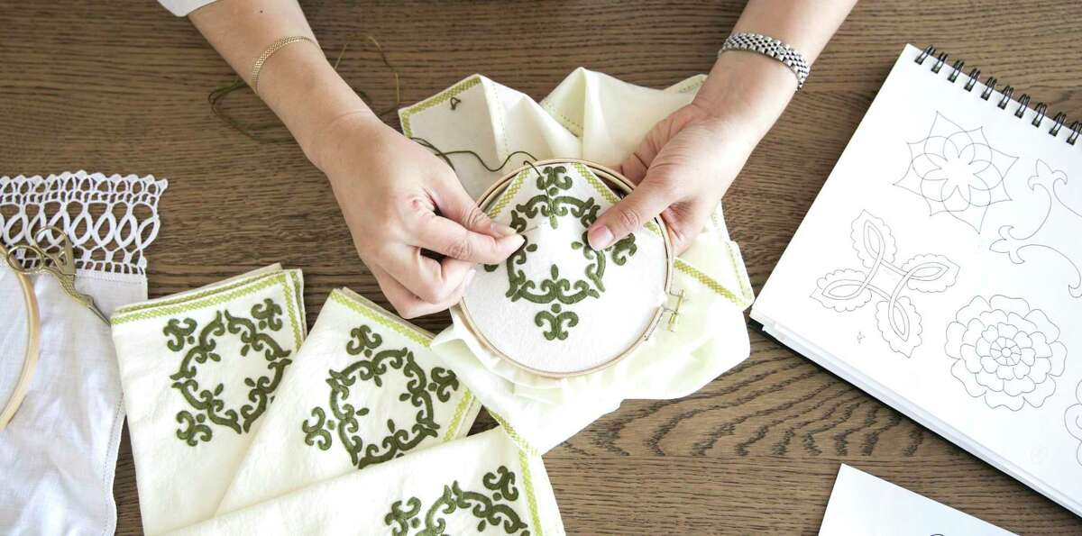 Hibiscus Linens founder, Mariana Barran Goodall, demonstrates how she embroiders at the Houston store on Wednesday, June 6, 2018. (Elizabeth Conley/Houston Chronicle)