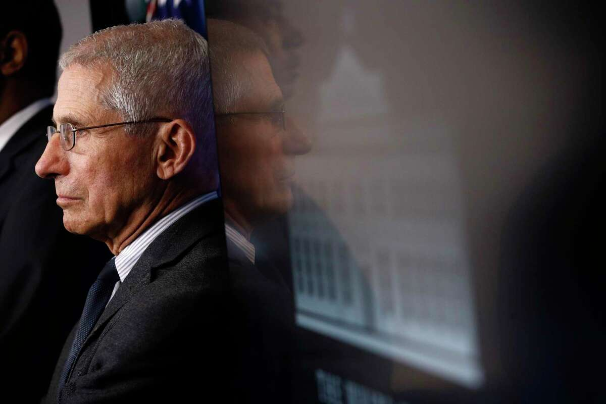 Director of the National Institute of Allergy and Infectious Diseases Dr. Anthony Fauci listens as President Donald Trump speaks during a coronavirus task force briefing at the White House, Saturday, March 21, 2020, in Washington. (AP Photo/Patrick Semansky)