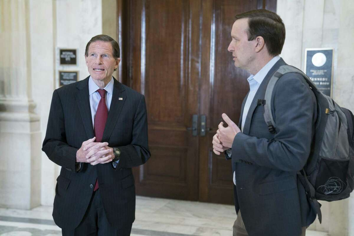 Senators Richard Blumenthal, left, and Chris Murphy, Democrats from Connecticut, depart from a Democratic caucus meeting in the Russell Senate Office Building in Washington, D.C., U.S., on Sunday, March 22, 2020. The latest draft of Senate Republicans' rescue package has swollen with hundreds of billions in additional spending, including more aid for the poor, the unemployed and health care, but Majority Leader Mitch McConnell has yet to win the agreement of House Speaker Nancy Pelosi and Senate Minority Leader Chuck Schumer. Photographer: Sarah Silbiger/Bloomberg