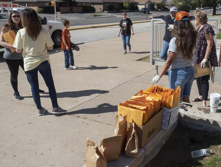 MISD staff distribute lunches and work packets 03/23/2020 outside Goddard Junior High. Tim Fischer/Reporter-Telegram Photo: Tim Fischer/Midland Reporter-Telegram