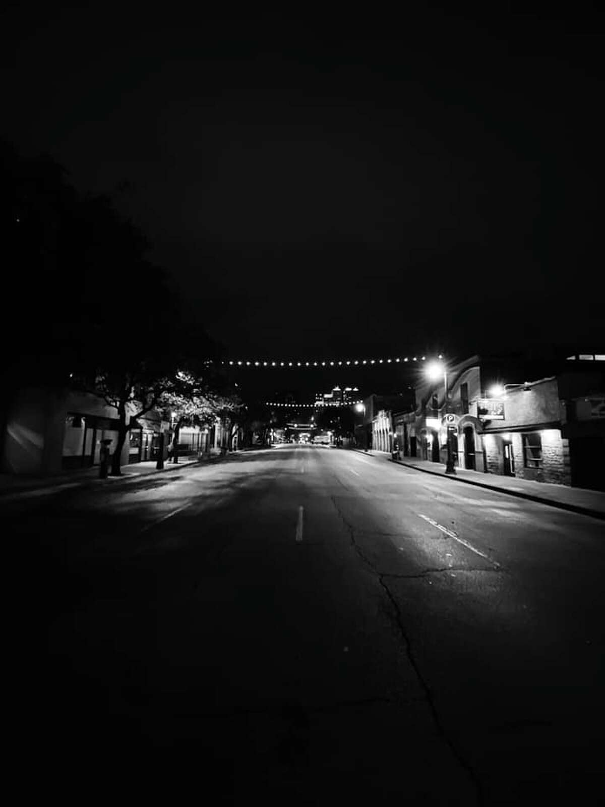 """Longtime resident Andrei Matei captured the """"eerie"""" and """"empty"""" streets of Austin's Sixth Street last Tuesday."""