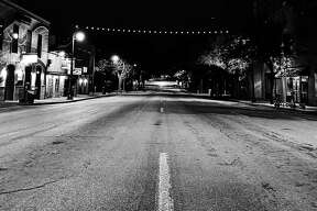 """Longtime resident Andrei Matei captured the """"eerie"""" and """"empty"""" streets of Austin's 6th street last Tuesday."""