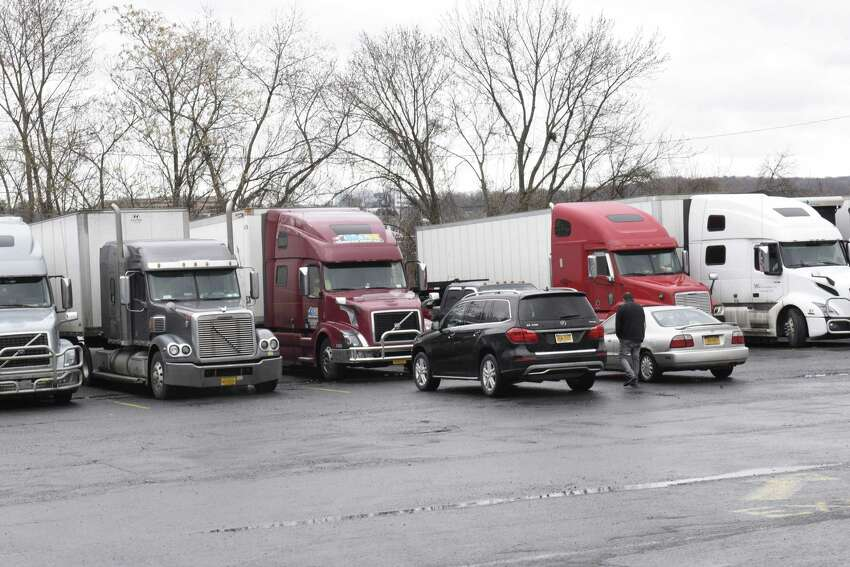 Truckers are seen parked at the Plaza 23 truck stop on Monday, March 23, 2020 in Albany, N.Y. Drivers are finding new hurdles as they try to deliver the goods, including limited opportunities for food and showers. (Lori Van Buren/Times Union)