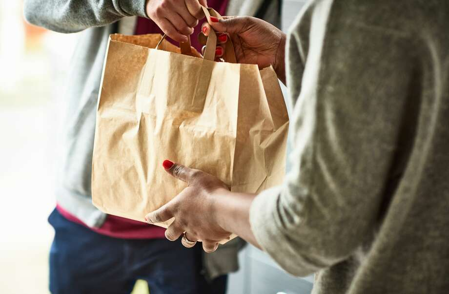 If you take a few common-sense precautions, ordering take-out is a low-risk food option. Photo: 10'000 Hours/Getty Images / Gary Burchell