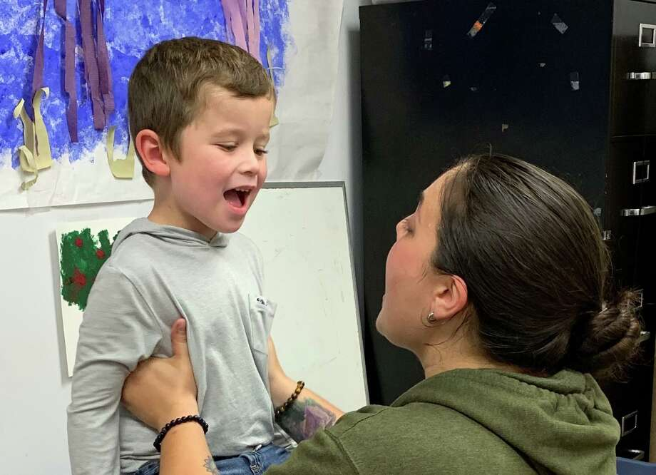 Tucker Zimmerman receives speech therapy from Elisa Isabella-Valenzi of the Communication Clinic of Connecticut Photo: Contributed Photo / Connecticut Post