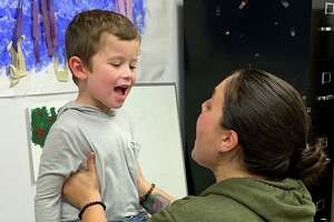 Tucker Zimmerman receives speech therapy from Elisa Isabella-Valenzi of the Communication Clinic of Connecticut