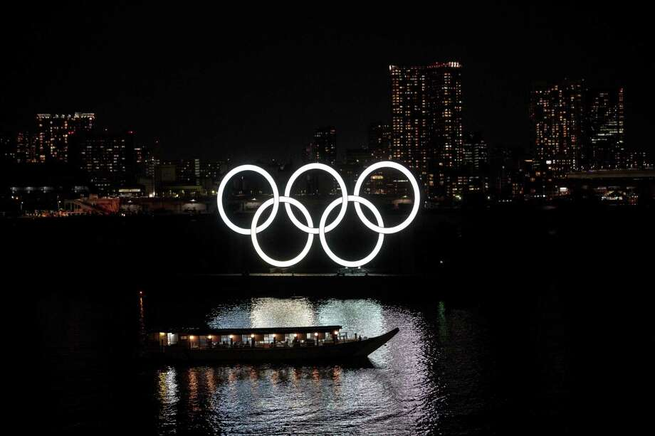 The Olympic rings are seen in Tokyo's Odaiba district on March 23, 2020. Photo: BEHROUZ MEHRI / AFP Via Getty Images / AFP or licensors