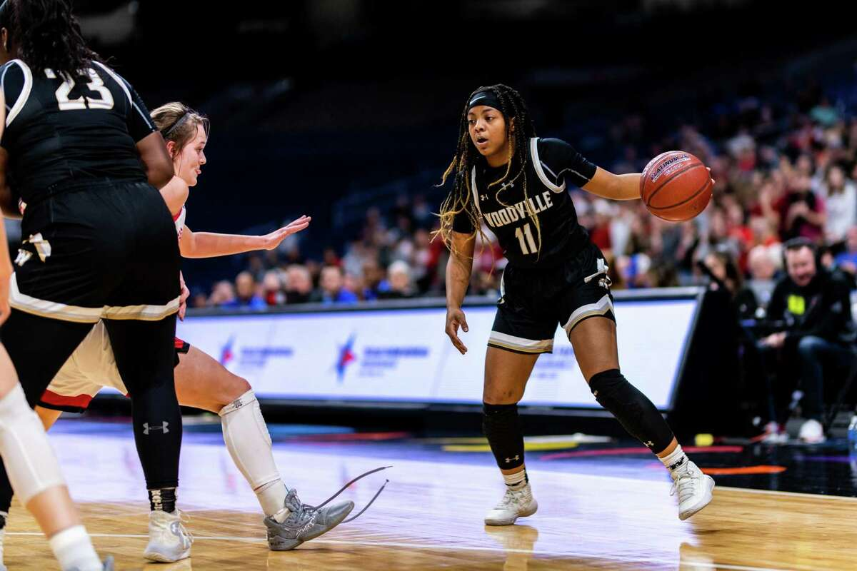 Jayda Argumon (11) attempts to dribble around a defender during the 1st half of the 3A State Championship game between Woodville and Shallowater at the Alamodome in San Antonio on March 7th, 2020.