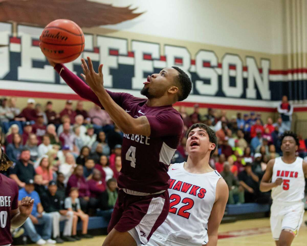 The Tigers Braelon Bush (4) puts up a shot in the first quarter as Silsbee traveled to Hardin-Jefferson in a battle for the lead in the division on February 11, 2020. Fran Ruchalski/The Enterprise