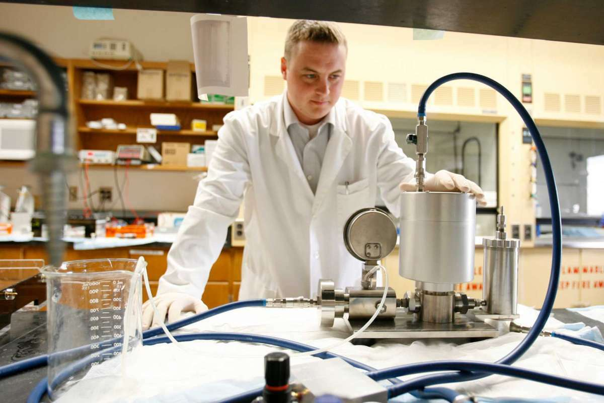 Dr. Brenton Scott, chief operating officer of Houston-based Pulmotect, works in the company's lab.