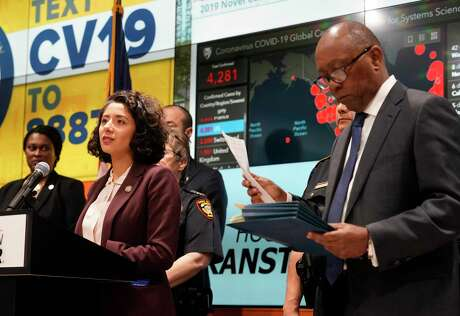 Harris County Judge Lina Hidalgo, left, and Houston Mayor Sylvester Turner, right, with others hold a COVID-19 news conference at Houston TranStar, 6922 Katy Road, Monday, March 16, 2020, in Houston. They announced that starting tomorrow for 15 days, restaurants with be takeout only and all bars will be closed.