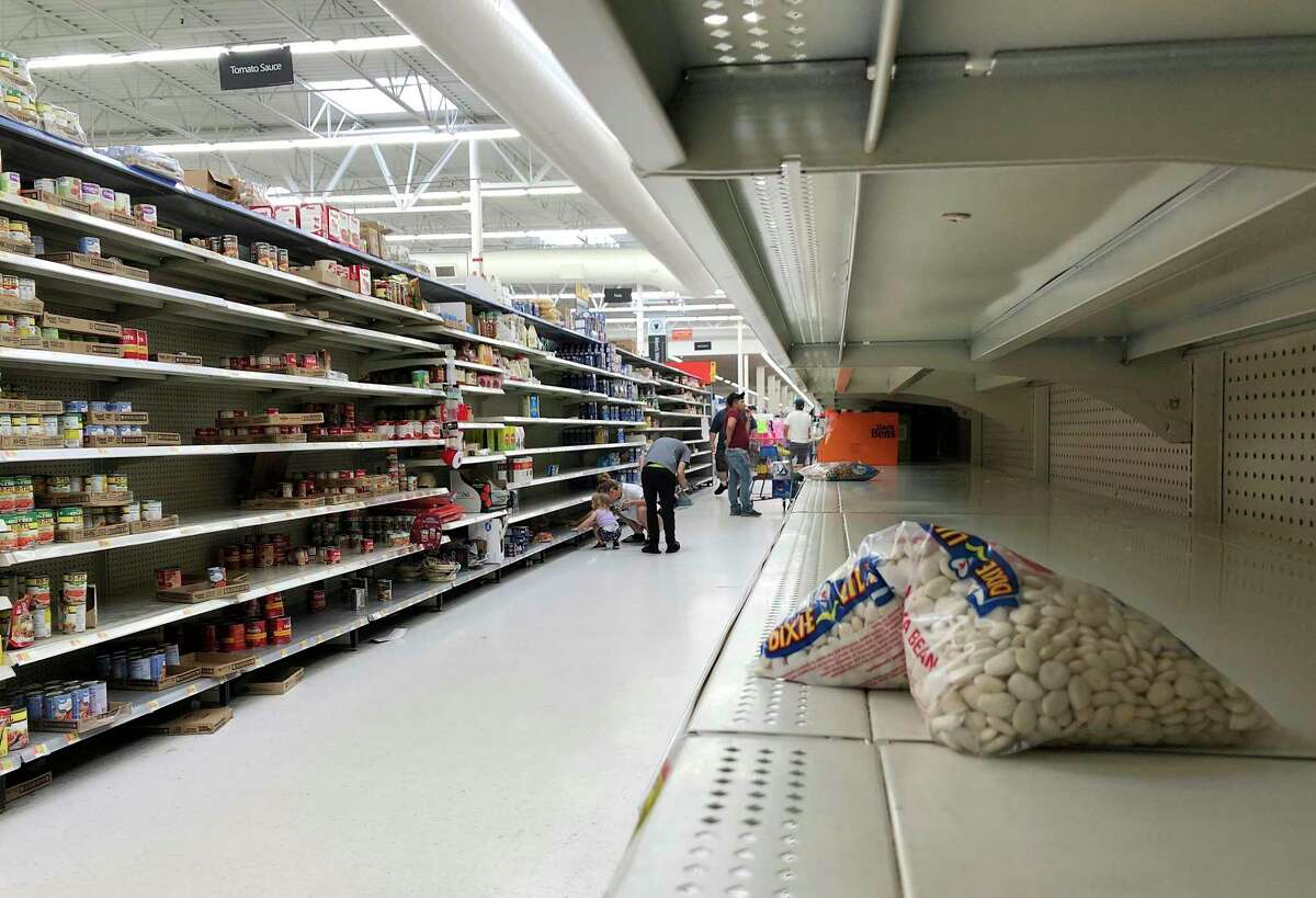 Shelves cleared of groceries at a Walmart in Jacksonville, Fla., on Sunday, March 22, 2020.