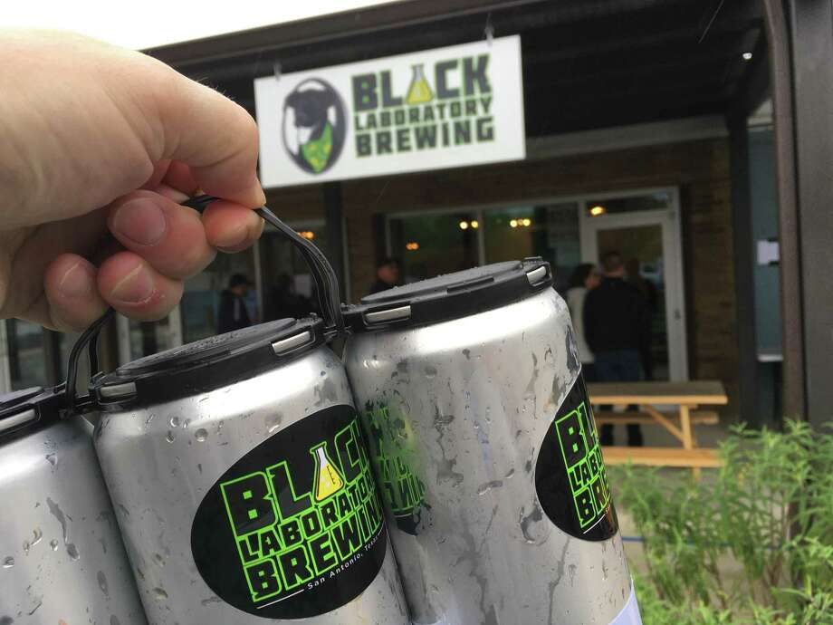 Black Laboratory Brewing is now selling five types of beer in 32-ounce to go crowler cans. Photo: Chuck Blount /Staff