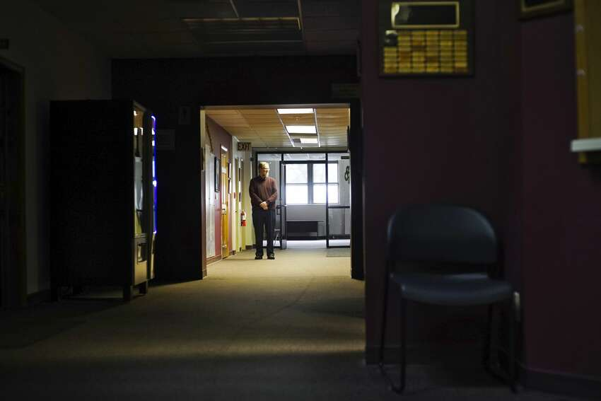 East Greenbush Supervisor Jack Conway stands in an empty part of town hall on Monday, March 23, 2020, in East Greenbush, N.Y. East Greenbush has closed it's parks and almost all town hall workers are working from home. (Paul Buckowski/Times Union)