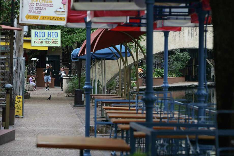 Few people are seen along the San Antonio River Walk in mid-March after restaurants were closed except for takeout or delivery orders. County officials have set aside $35 million in federal CARES Act funding, out of a total of nearly $80 million, to develop a training program for 5,000 workers. Officials are expected to develop a framework for a training initiative when the City Council meets virtually Wednesday, according to Mayor Ron Nirenberg. Photo: Jerry Lara /Staff Photographer / **MANDATORY CREDIT FOR PHOTOG AND SAN ANTONIO EXPRESS-NEWS/NO SALES/MAGS OUT/TV   © 2019 San Antonio Express-News