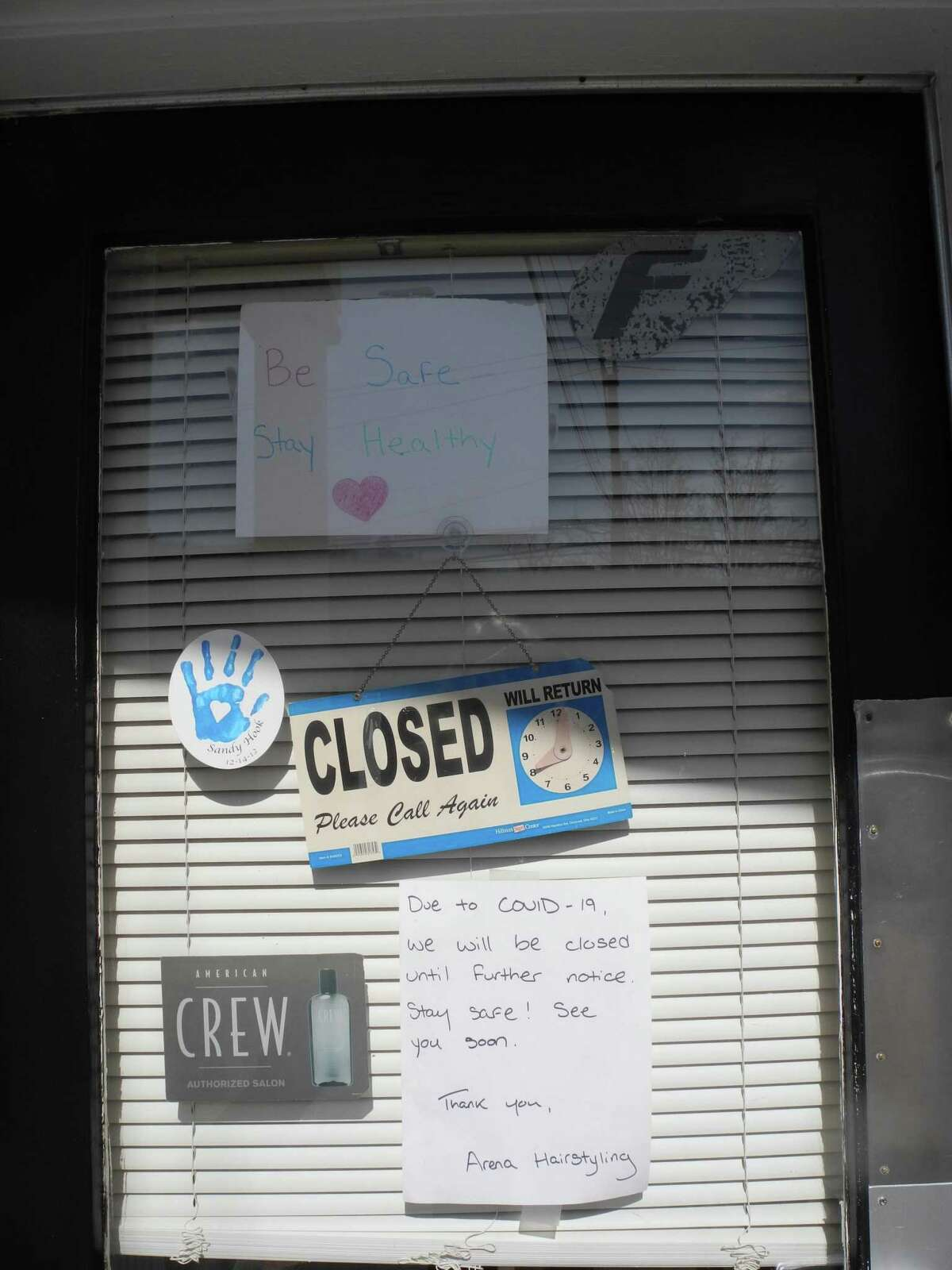 """The """"closed"""" sign at Arena Hairstyling is indicative of some, but not all Wilton businesses."""