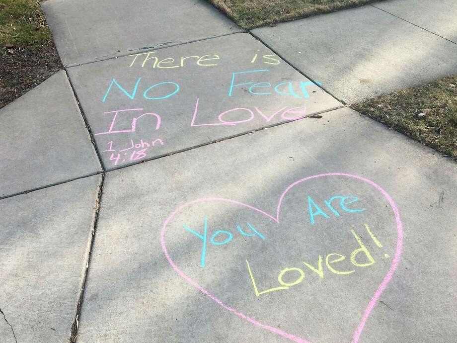 On Sunday morning, a few members of Memorial Presbyterian Church wrote positive messages on the sidewalks. It is part of a movement, Chalk Your Walk, that is gaining momentum via social media to spread cheer in the neighborhood as people are socially distancing. (Photos by William Kirkpatrick and Stephanie Lewandowski)
