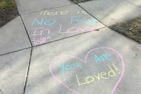 On Sunday morning, a few members of Memorial Presbyterian Church wrote positive messages on the sidewalks. It is part of a movement, Chalk Your Walk, that is gaining momentum via social media to spread cheer in the neighborhood as people are socially distancing. (Photos byWilliam Kirkpatrick and Stephanie Lewandowski)