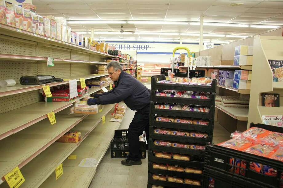 Aunt Millie's delivery-man Kurt Sanchez stocks bread at the Pigeon IGA Monday. (Sara Eisinger/Huron Daily Tribune)