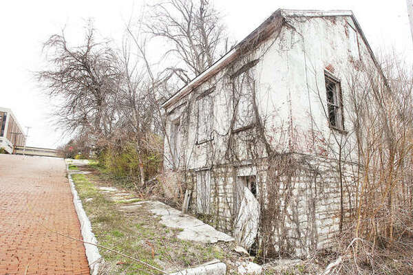 An historic Alton home at 313 Oak St., right, is on the demolition list for 2020. The small limestone-foundation structure is located just down the street from St. Clare's medical facility, left.