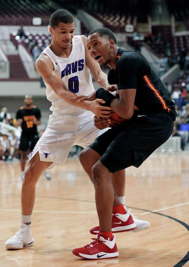 Morton Ranch's Westley Sellers (0) and Yates' Elijah Elliott, right, grapple for the ball during the second half of a high school basketball game Saturday, Nov. 16, 2019 in Houston, TX. Photo: Michael Wyke / Contributor / © 2019 Houston Chronicle