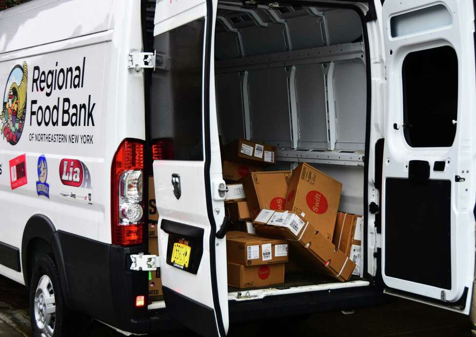 A truck from theRegional Food Bank of Northeastern brings 2,500 pounds of food to Yono's restaurant in Albany on Monday, March 23, 2020. The food bank is giving food to restaurants that have supported it in the past to make meals for their employees who have been put out of work by government-ordered closures as a result of the COVID-19 pandemic. Seven area restaurants will be receiving food that could supply their staffs with weeks' worth of meals.