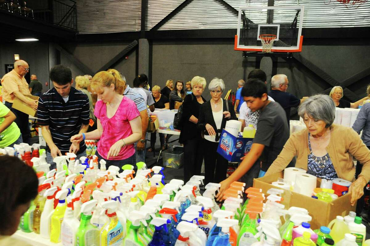 Members of Foundry United Methodist Church and Cy-Hope assemble care packages on Sunday, April 24 for people who have been affected by the flood.
