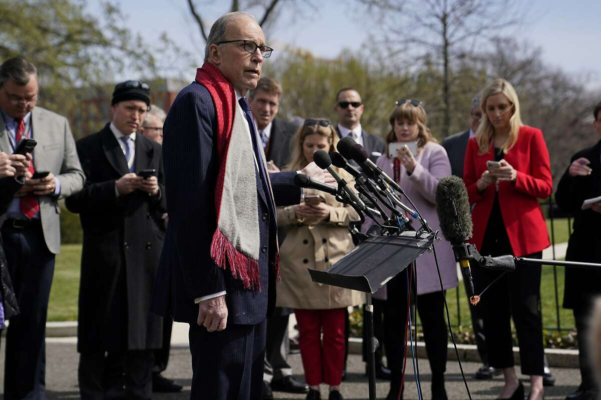 White House chief economic adviser Larry Kudlow talks to reporters about the economic impact of the coronavirus, at the White House, Monday, March 16, 2020, in Washington. (AP Photo/Evan Vucci)