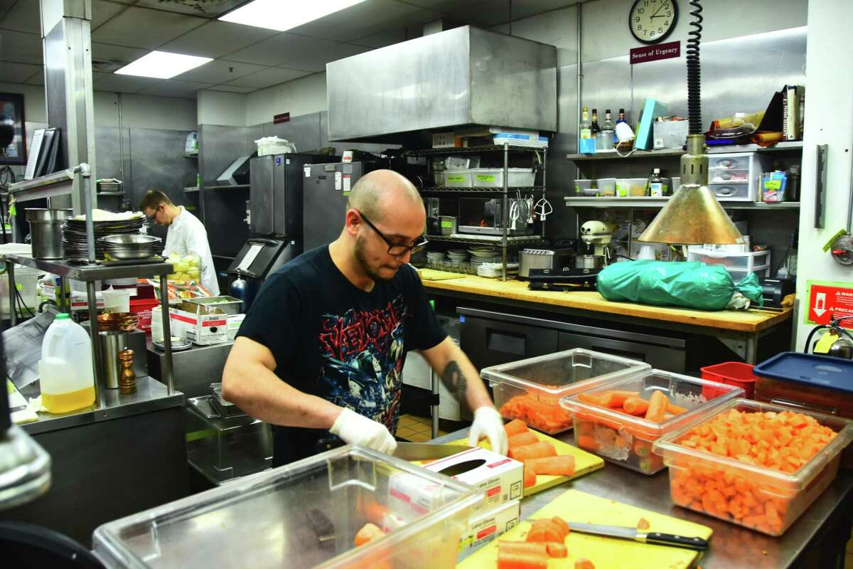 P.J. Rawson, a cook at Savoy Taproom in Albany, volunteers his time at Yono's restaurant in Albany on Monday, March 23, 2020, to prepare food for Feed Albany. Using donated food and labor, the new campaign is making thousands meals for restaurant employees who have been put out of work by government-ordered closures as a result of the COVID-19 pandemic as well as at-risk and in-need individuals.
