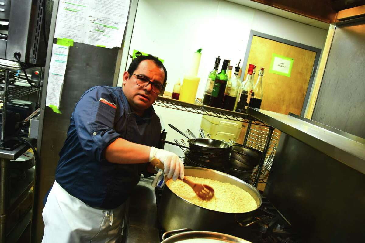 Miguel Perez,an employee of Draught Industries in Beacon, volunteers his time at Yono's restaurant in Albany on Monday, March 23, 2020, to prepare food for Feed Albany. Using donated food and labor, the new campaign is making thousands meals for restaurant employees who have been put out of work by government-ordered closures as a result of the COVID-19 pandemic as well as at-risk and in-need individuals.